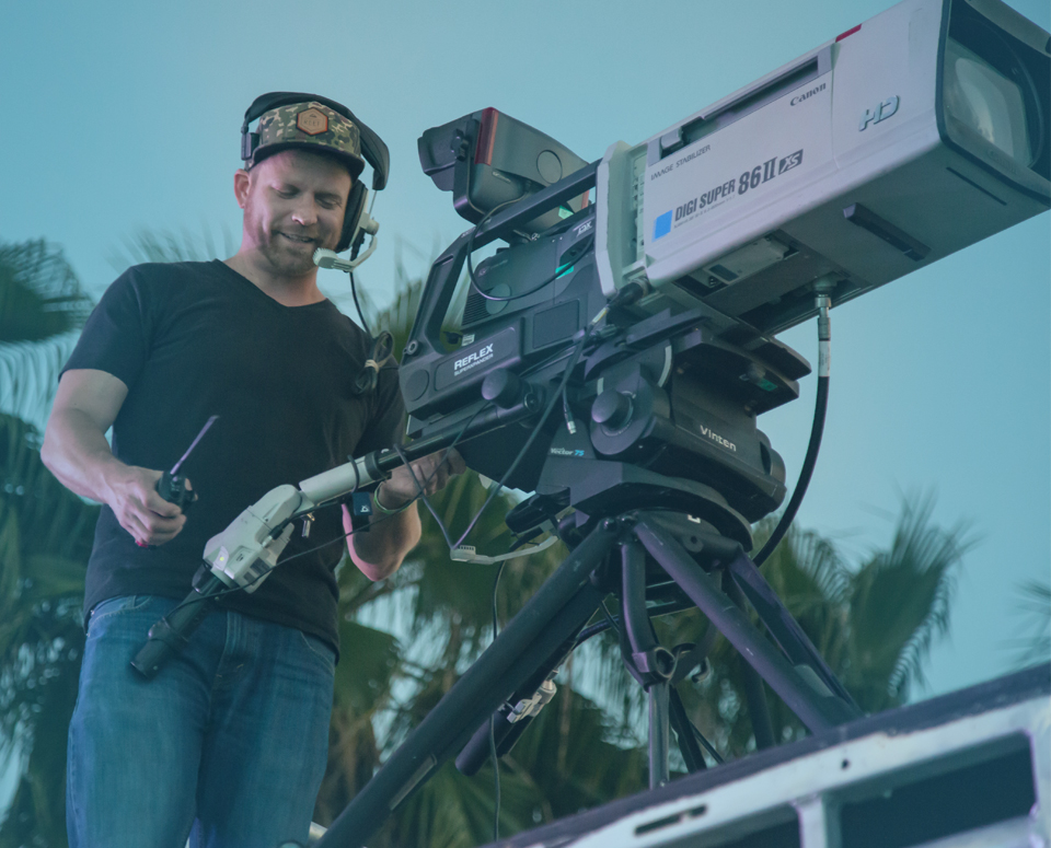 Clair video technician operating video camera on location